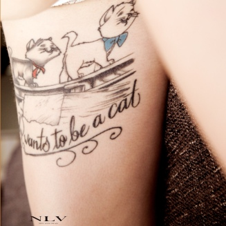 marie-thigh-tattoo-4